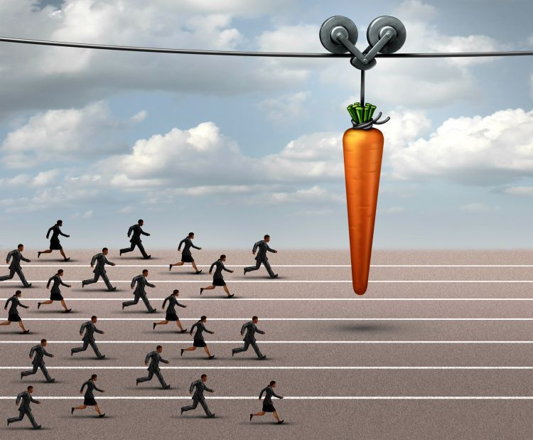 People chasing carrot on stick