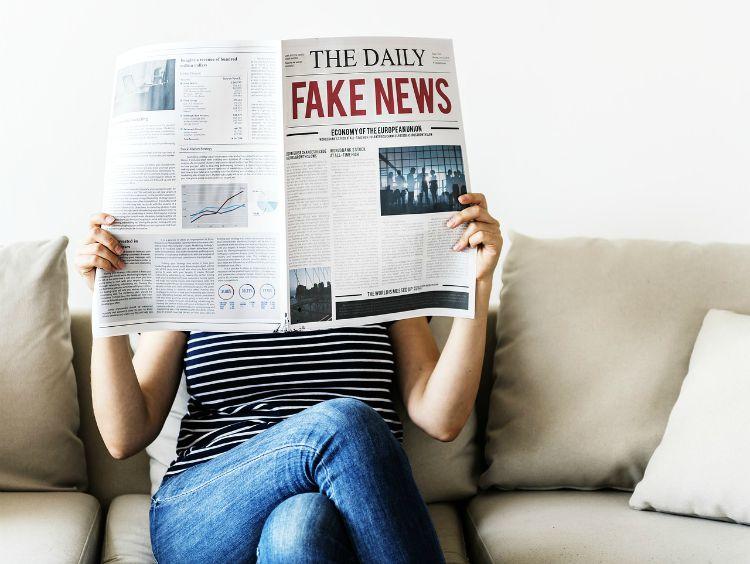 woman reading fake news