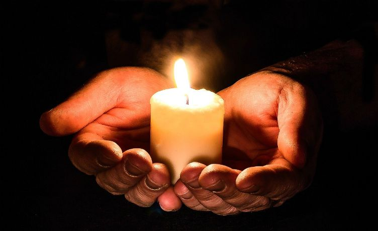 hands open candle