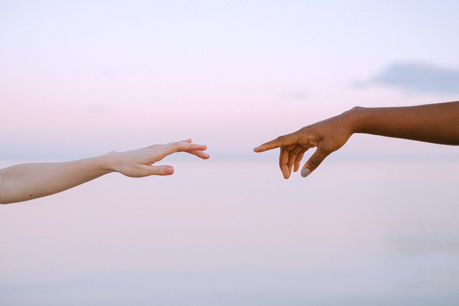 photo of people reaching each other s hands
